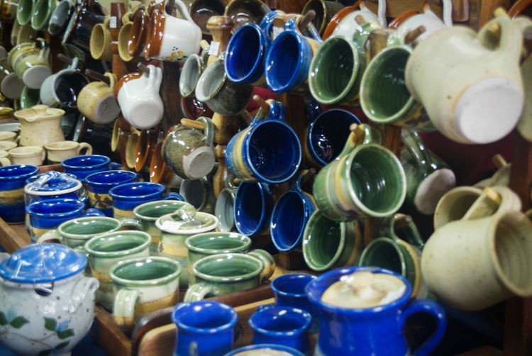 Close-up of various cups displayed for sale