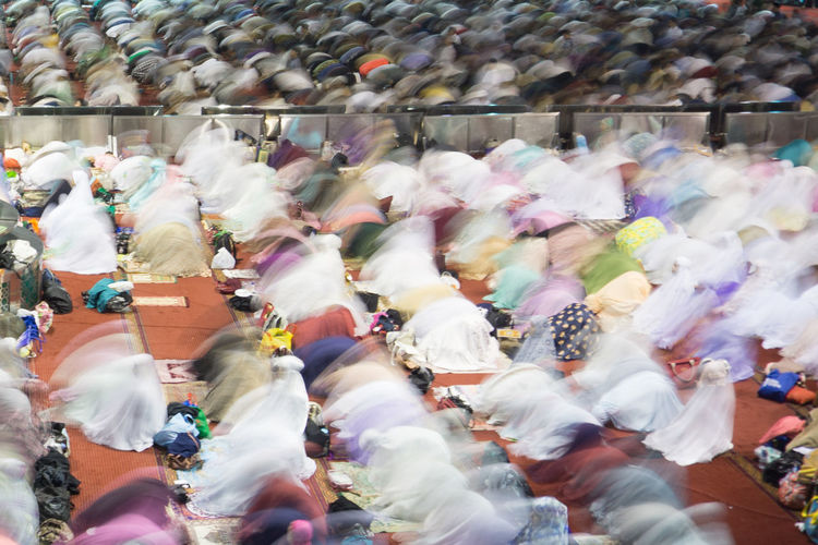 Blurred motion of people praying at mosque