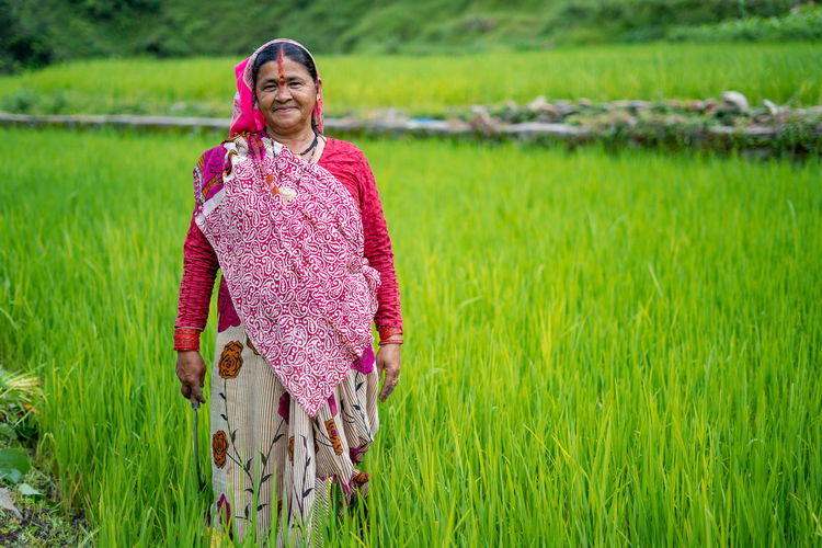 Portrait of mature woman standing at farm