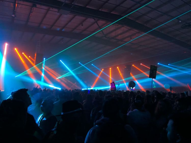 Rave Enjoyment Crowd Music Performance Arts Culture And Entertainment Large Group Of People Real People Event Illuminated Lighting Equipment Group Of People Audience Light Night Stage - Performance Space Excitement Popular Music Concert Fun Nightlife Stage