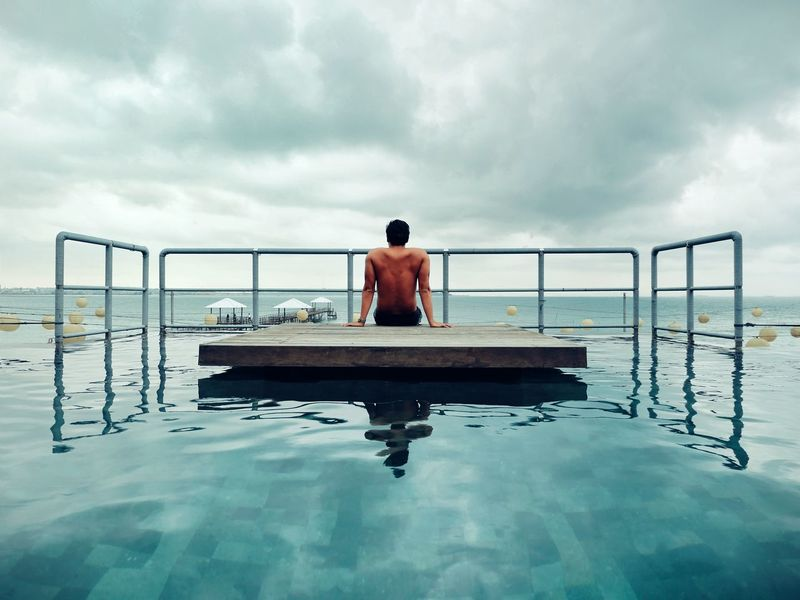 One Man Only Back Cloud Water Young Adult Mirror Reflection Jetty Pool Travel SeaRelaxation Outdoors People Day Serenity Horizon Over Water Cloud - Sky Sommergefühle