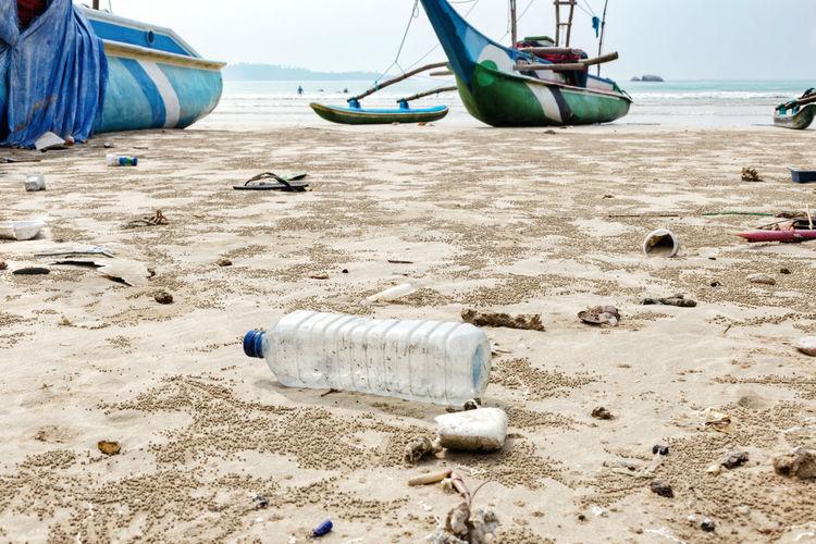 Abandoned water bottle on beach