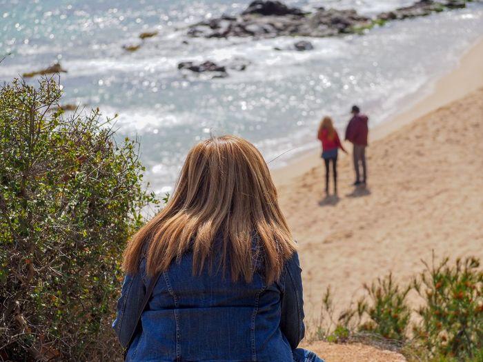 Rear view of girl at beach