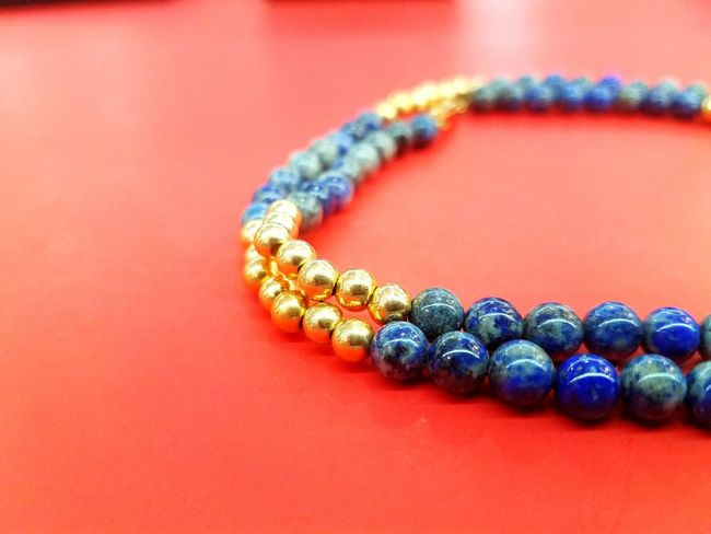 Day 9. Blue lapis and gold bead necklace. Lapis Gold Necklace Red Color 365project Fashion Jewelry Colored Background Luxury Studio Shot Red Arts Culture And Entertainment Glamour No People Elégance Shiny Indoors  Multi Colored Beauty Close-up Day