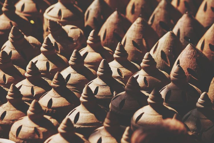 Indian piggy bank made up of mud or clay Handmade Money Bank Pottery Art And Craft Pattern Pattern, Texture, Shape And Form Home Coin Piggy Bank Tradition Creative Concept  Mud Clay Close-up Earthenware Pottery Ceramics Molding A Shape Art Class Sculptor Pot My Best Photo