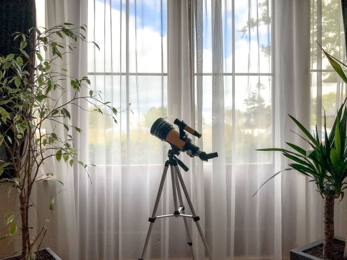 Telescope at window