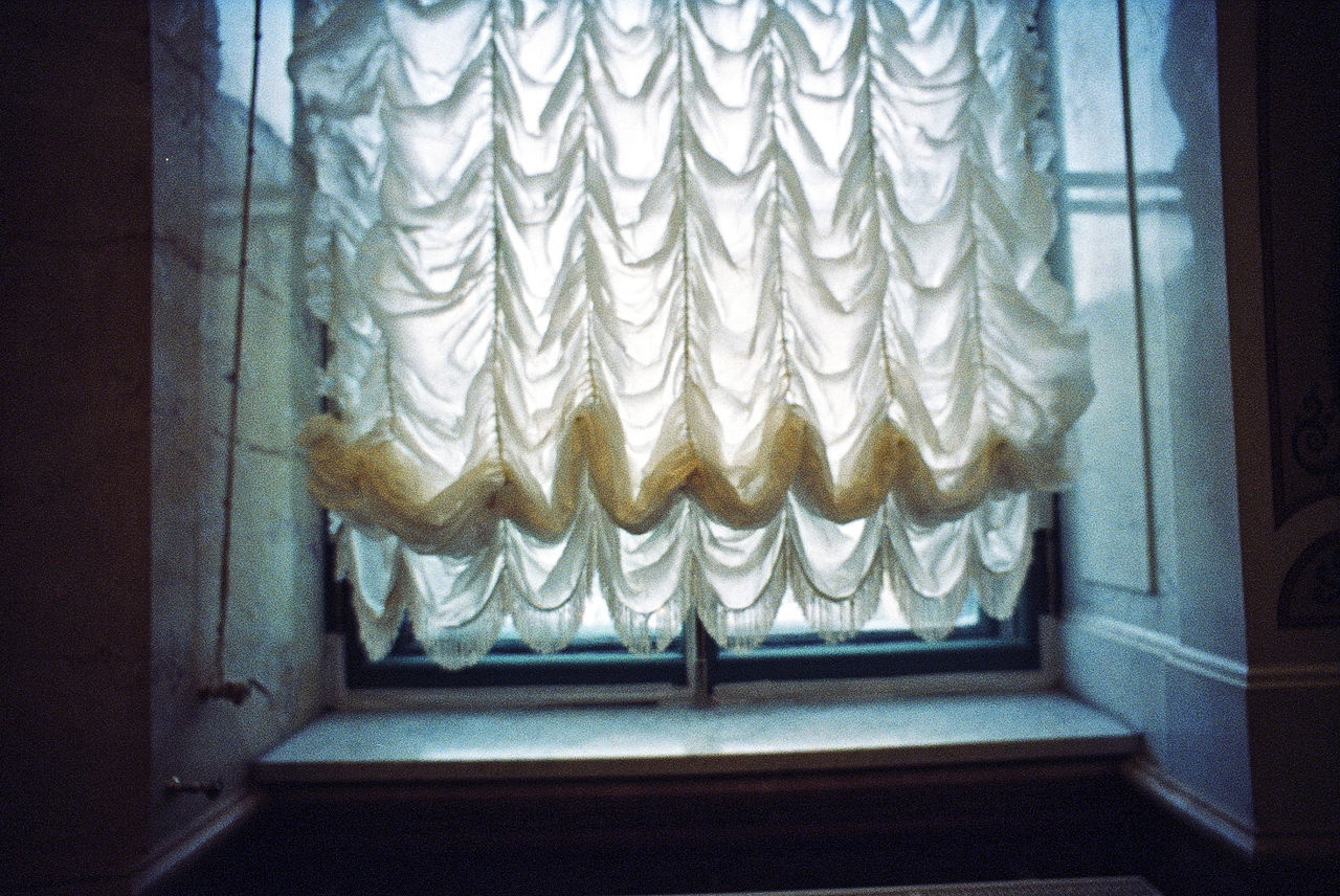 Close-Up Of Curtained Window