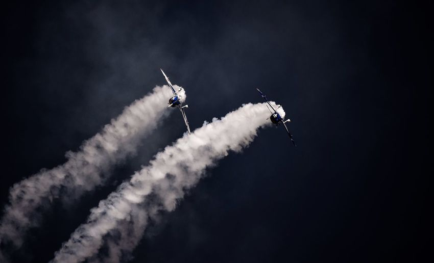 Smoke - Physical Structure Airshow Speed Transportation Air Vehicle Vapor Trail Low Angle View Mode Of Transport Teamwork Sky Flying Airplane Fighter Plane Performance Outdoors Aerobatics Mid-air Military Airplane Stunt Motion