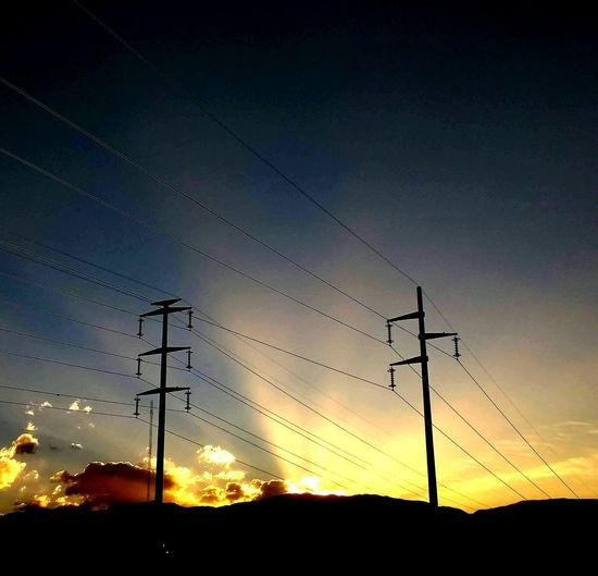 The power of sun Cable Connection Electricity  Electricity Pylon Low Angle View No People Power Line  Silhouette Sky Sunset Technology A New Beginning