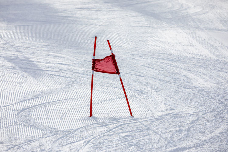 High Angle View Of Poles On Snow Covered Field