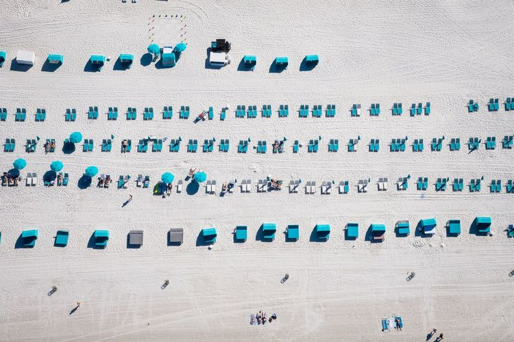 Aerial View Of Sun Loungers On Beach