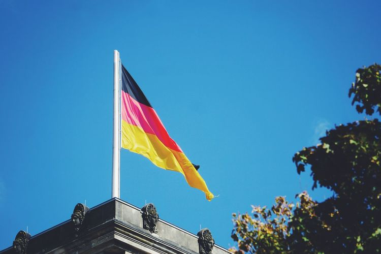 Low Angle View Of German Flag On Building Against Sky
