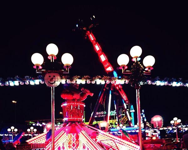 Illuminated Carousel Night Fun No People Amusement Park Amusement Park Ride Rollercoaster Multi Colored