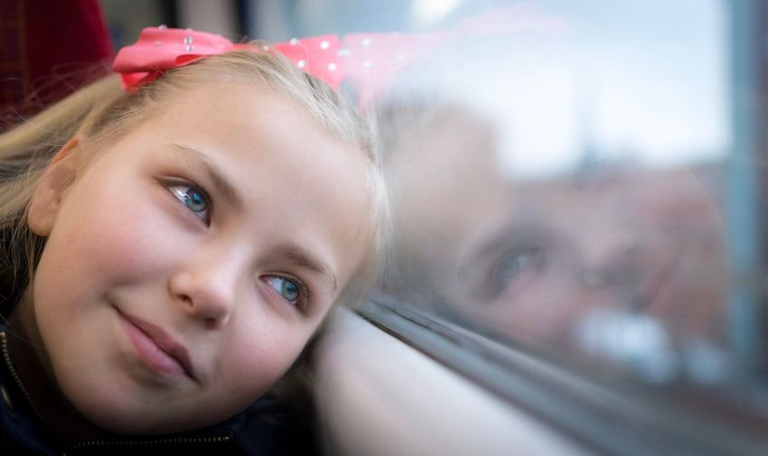 Beauty reflected Looking At Camera Portrait Headshot Girls Blond Hair Close-up Lifestyles Child Real People Indoors  Two People Smiling Beauty Childhood Happiness Day People Human Body Part Adult Reflections Reflection Train Reflection_collection Window The Portraitist - 2017 EyeEm Awards