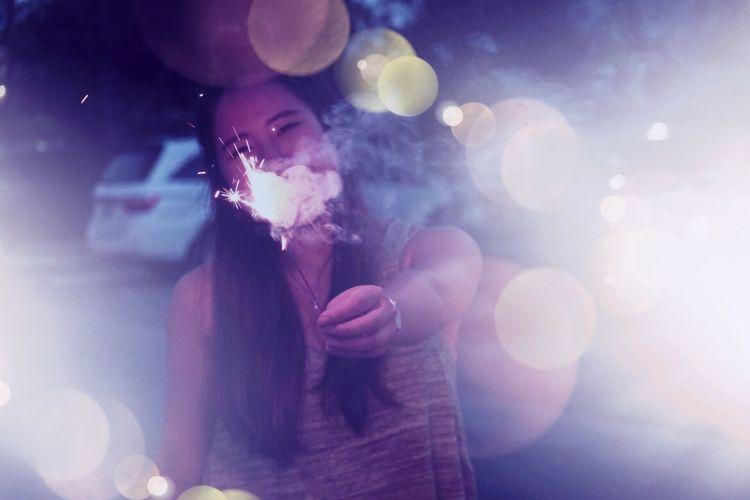 Close-Up Of Young Woman Smoking Outdoors
