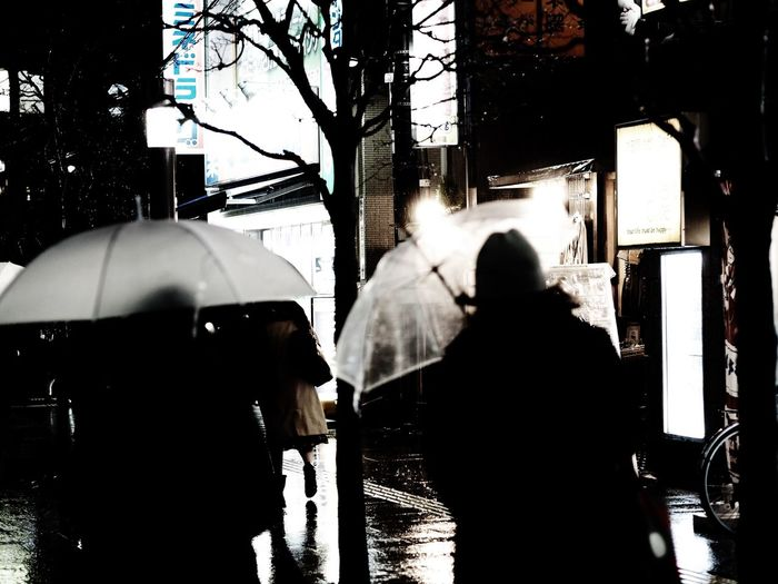 A rainy day. Tokyo Street Photography Rainy Days Umbrella Real People Rear View Men Women Walking Lifestyles Car