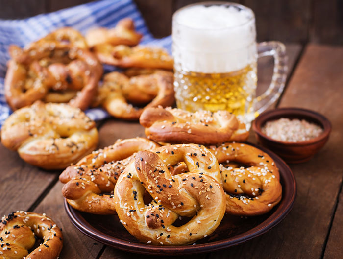 Close-up of breads and beer on table