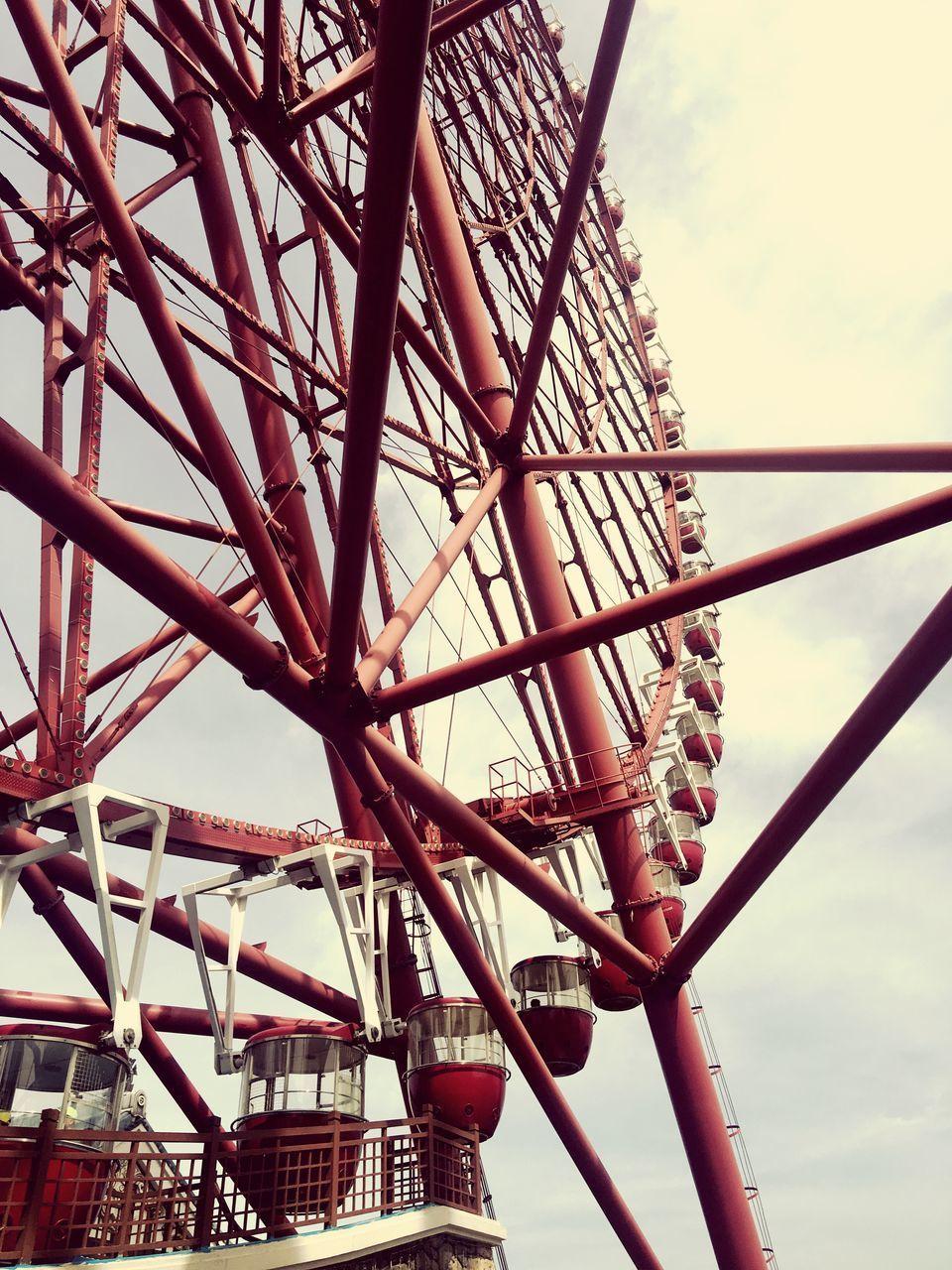 sky, low angle view, amusement park, amusement park ride, arts culture and entertainment, metal, ferris wheel, day, built structure, nature, architecture, no people, cloud - sky, fairground, outdoors, leisure activity, large, tall - high, grid, tourism, steel