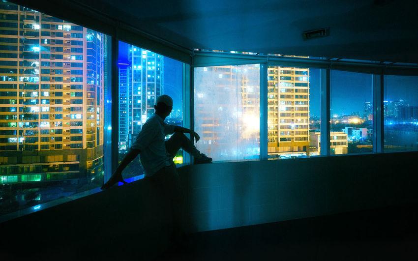 Man sitting in glass window