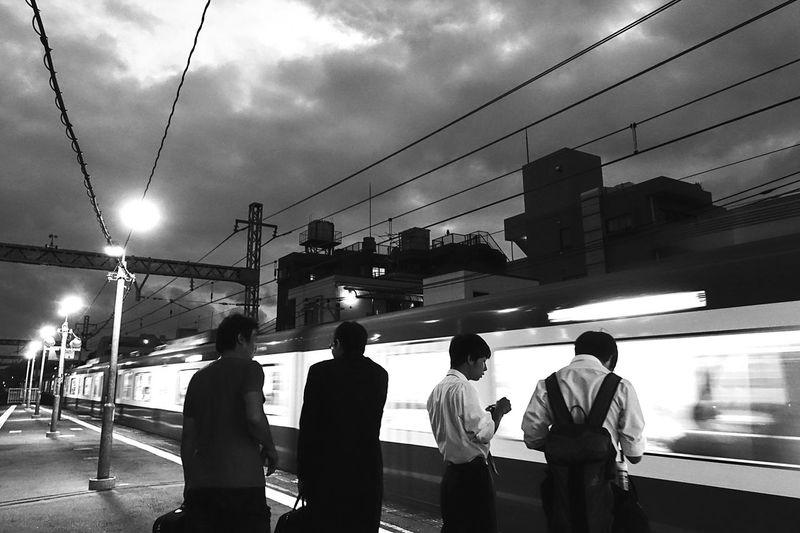 Train Station Train Passing Evening Black And White Blackandwhite Monochrome City Life Cityscapes Station Platform Yokohama, Japan Station Sony Sony Rx100 M3 Rx100m3 横浜 京浜急行 黄金町 EyeEm Japan On The Way People And Places The City Light
