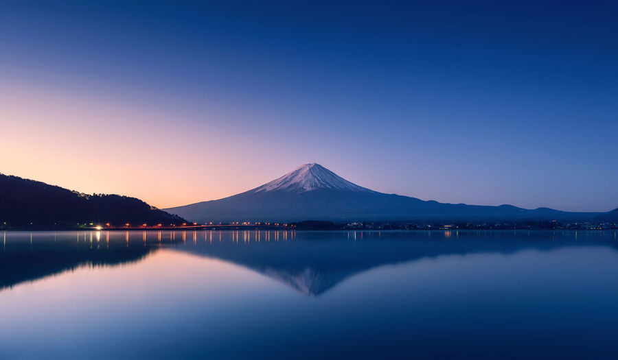mountain Fuji at dawn with peaceful lake reflection Blue Hour Mt.Fuji Beauty In Nature Blue Clear Sky Dawn Lake Landmark Mountain Nature No People Outdoors Peaceful Reflection Scenics Sky Sunrise Tranquil Scene Tranquility Water Waterfront