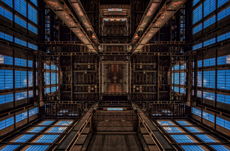 Ceiling of an abandoned factory Architecture Built Structure Indoors  No People Window Day Building Symmetry Directly Below The Past Pattern History Ceiling Architectural Feature Old Architecture And Art Abandoned Low Angle View Factory Industrial Forgotten Urbex Urbexphotography