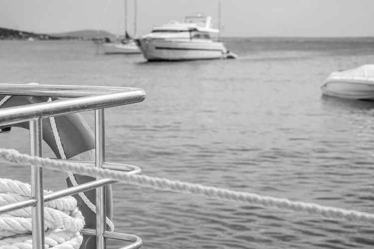 Black & White Beach Beauty In Nature Black And White Black And White Friday Boat Close-up Day Horizon Over Water Mode Of Transport Monochrome Moored Nature Nautical Vessel No People Outdoors Sailing Sailing Ship Scenics Sea Sky Tranquil Scene Tranquility Transportation Water Yacht