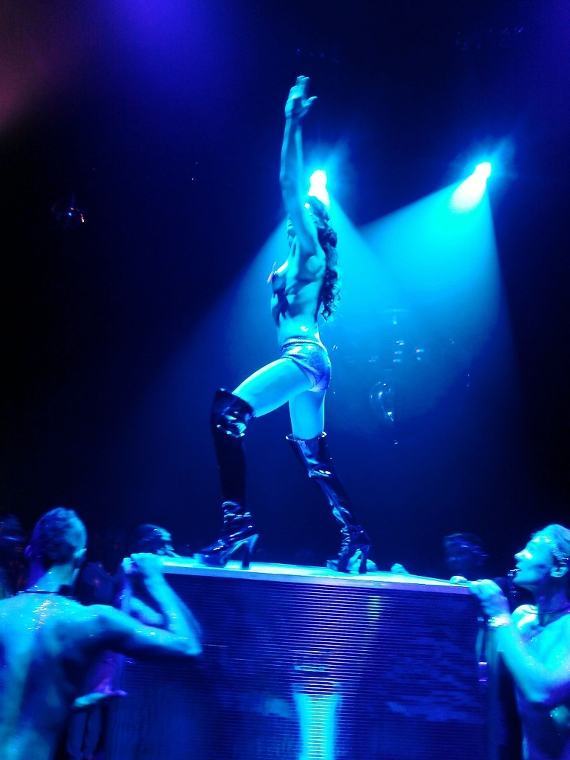 blue, night, men, illuminated, indoors, skill, leisure activity, arts culture and entertainment, lifestyles, occupation, underwater, performance, smoke - physical structure, music, motion, musical instrument, water, fire - natural phenomenon
