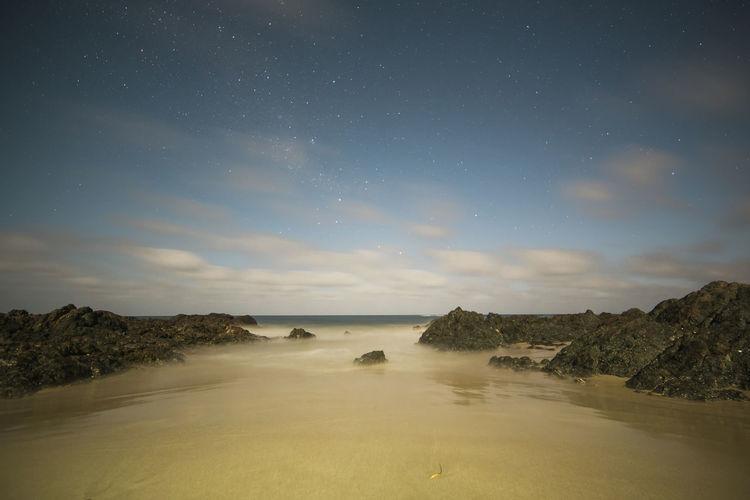 Australian Landscape Milky Way Sea And Sky Outdoors Sea Sand Beach Rock Formation Nightphotography Starscape No People Astrophotography Astronomy Scenics Stars Cloud Australia Beauty In Nature Landscape Tranquil Scene Southern Cross Rocky Coastline Nature