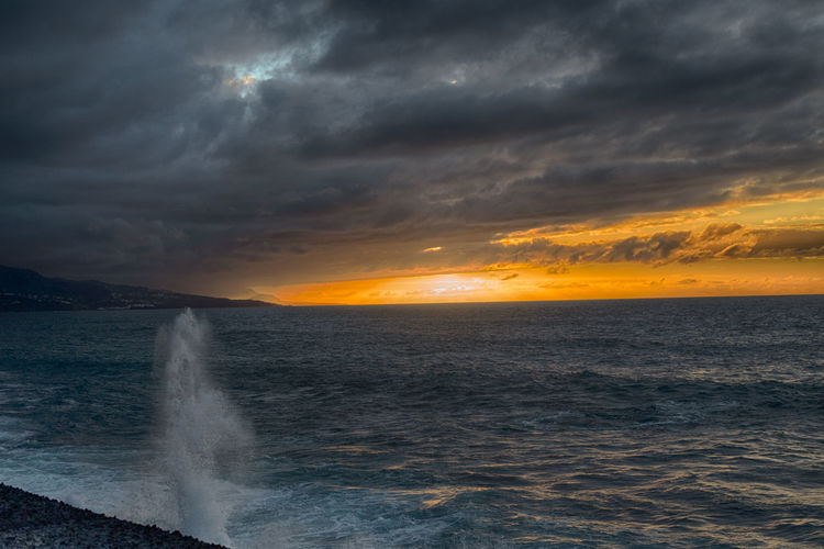 DARK DRAMATIC SKY OVER SEA AT SUNSET