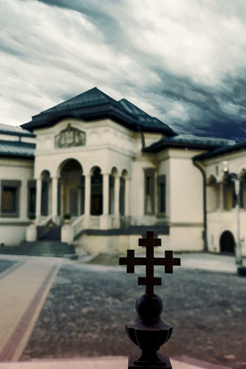 sky, architecture, building exterior, built structure, cloud - sky, religion, spirituality, cross, no people, outdoors, day, place of worship