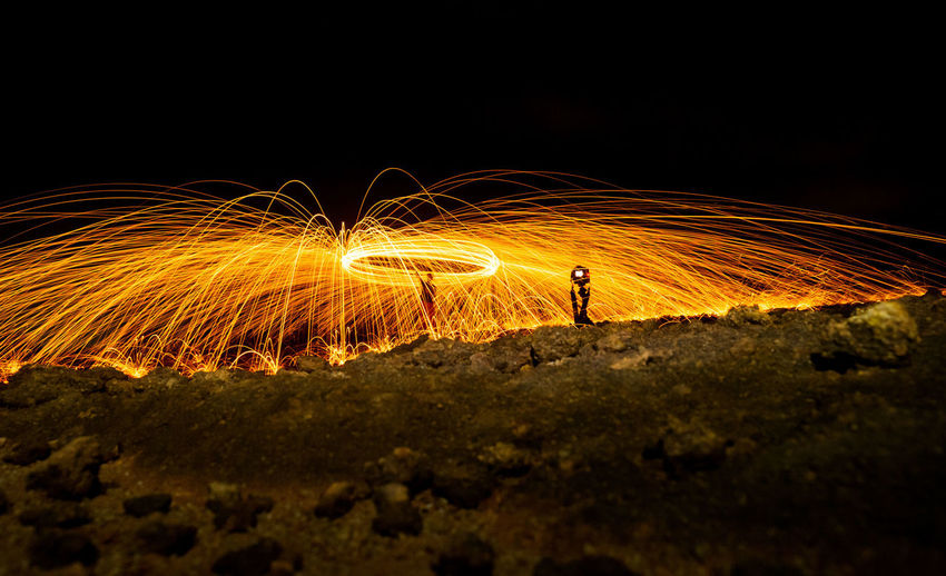 Steel Wool in Indonesia One Person Night Wire Wool Motion Long Exposure Real People Illuminated Blurred Motion Lifestyles Standing Spinning Men Full Length Glowing Sign Leisure Activity Nature Land Warning Sign Skill  Outdoors Light Trail Sparks