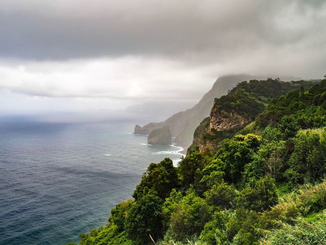 Sea Sky Nature Beauty In Nature Scenics Water Cloud - Sky Horizon Over Water Tranquility Outdoors Tranquil Scene No People Day Mountain Cliff Travel Destinations Landscape Dramatic Sky Madeira Madeira Island Santana