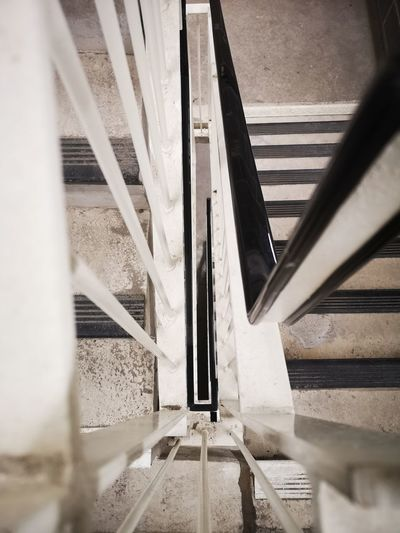 Down the stairs Looking Down Down EyeEm Gallery EyeEm Best Shots Vertigo Huawei P20 Pro Huawei P20 Pro Photography Architecture Close-up Built Structure Steps And Staircases Fire Escape Stairway Bannister Railing Emergency Exit Hand Rail Stairs Staircase Symmetry Steps