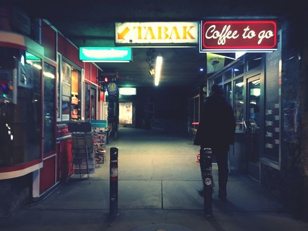 Uraban Walkway in Vienna with Shops Cigarette Store Coffee To Go