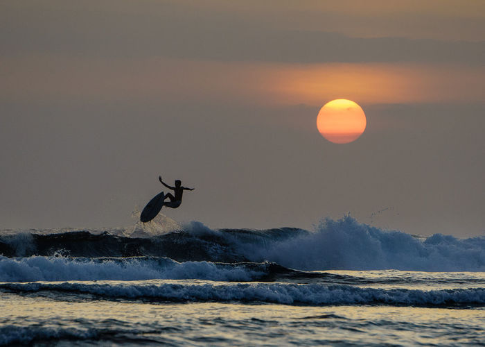 Rise up TheGreatOutdoors Siargao Island Choosephilippines Sunrise Flying Wave Sea Extreme Sports Water Sunset Mid-air Beach Silhouette Air Vehicle Surfing