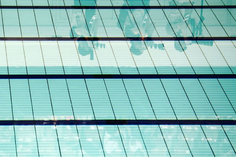 QUEER 6.39 PM Lines Press This Is Queer Abstract And The Winner Is ... Architecture Audience Backgrounds Black Blue Competition Directly Below Full Frame Go Higher Modern Photographers Reflection Structure Swimming Pool Turquoise Colored Water