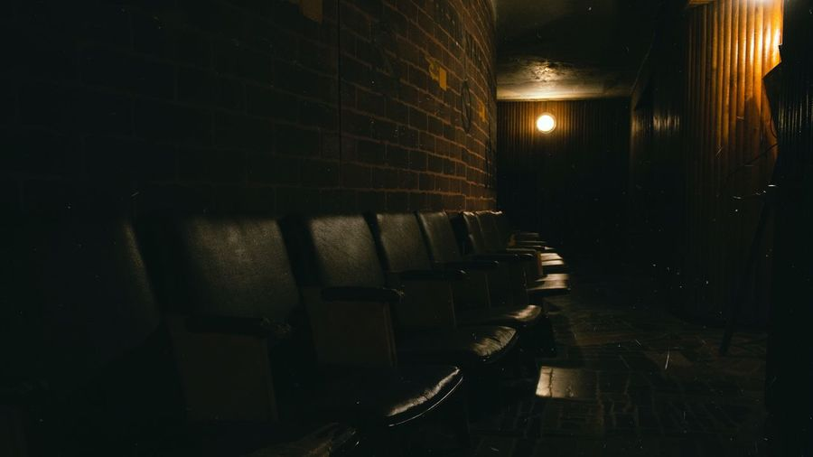 View of chairs adjacent to wall