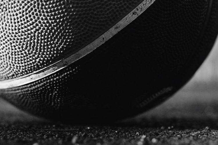 Basketball Close-up No People Still Life Indoors  Selective Focus Pattern Table Black Color Equipment Shiny Focus On Foreground Music Drop Single Object Design Leather Textured  Metal Detail