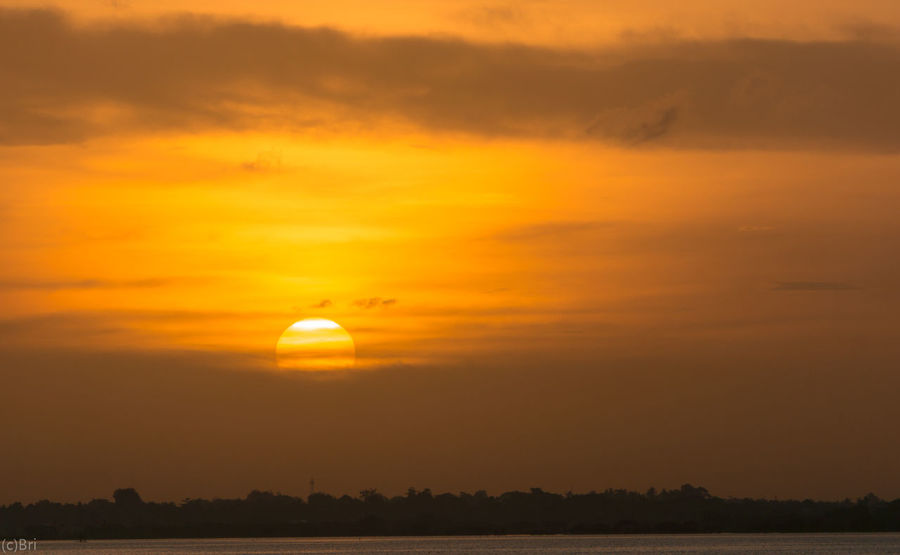 Sunset Sun Silhouette Orange Color Scenics Tranquility Beauty In Nature Nature Dramatic Sky Tranquil Scene Sky Dusk Outdoors Reflection Cloud - Sky Travel Destinations No People Moon Gold Colored Yellow