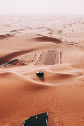 Hidden roads. Desert Dubai Land Sand Beach Water Desert Sea Sand Dune Nature Beauty In Nature Scenics - Nature Tranquility Landscape High Angle View Sky Non-urban Scene Land Vehicle Car Tranquil Scene Mode Of Transportation No People