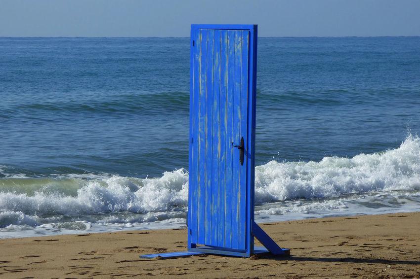 Aquatic Sport Beach Beauty In Nature Blue Day Door Door On The Beach Horizon Horizon Over Water Land Motion Nature Outdoors Sand Scenics - Nature Sea Sky Water Wave