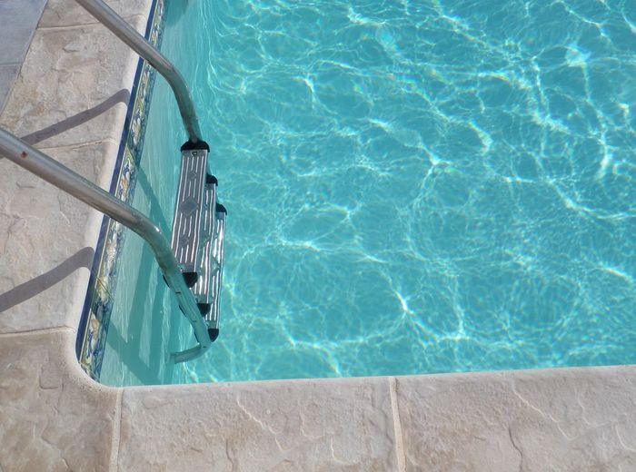 Absence Blue Close-up Day Edge Of Pool With Steps High Angle View Metal Metallic Pool Steps No People Outdoors Pool Pool Step Poolside Rippled Rippled Water Sunlight Swimming Pool Tiles Water Water Reflections