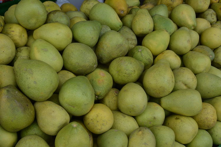 Abundance Backgrounds Citrus  Citrus Fruit Day Food Food And Drink Freshness Fruit Full Frame Green Color Green Color Healthy Eating Large Group Of Objects Market No People Outdoors Pomelo Large Group Of Object Retail
