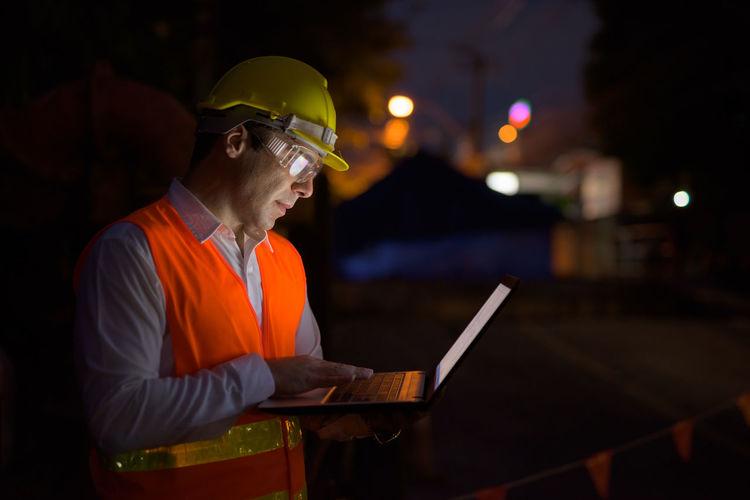 Man working on laptop at night