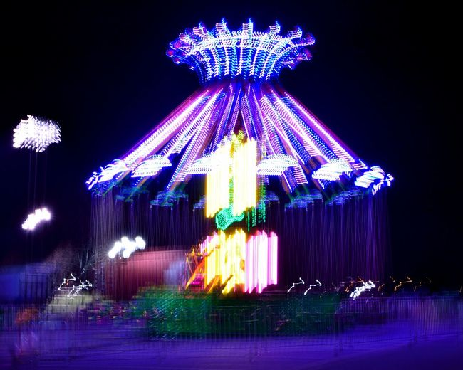 Acid at the Carnival Amusement Park Illuminated Blurred Motion No People Carousel Multi Colored Amusement Park Ride Night Tones Inventive Colorful High Contrast Neon