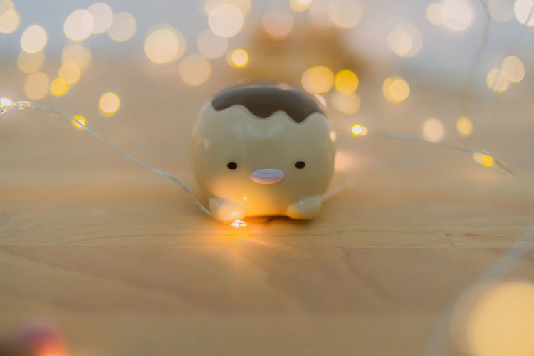 Close-up of illuminated toy on table