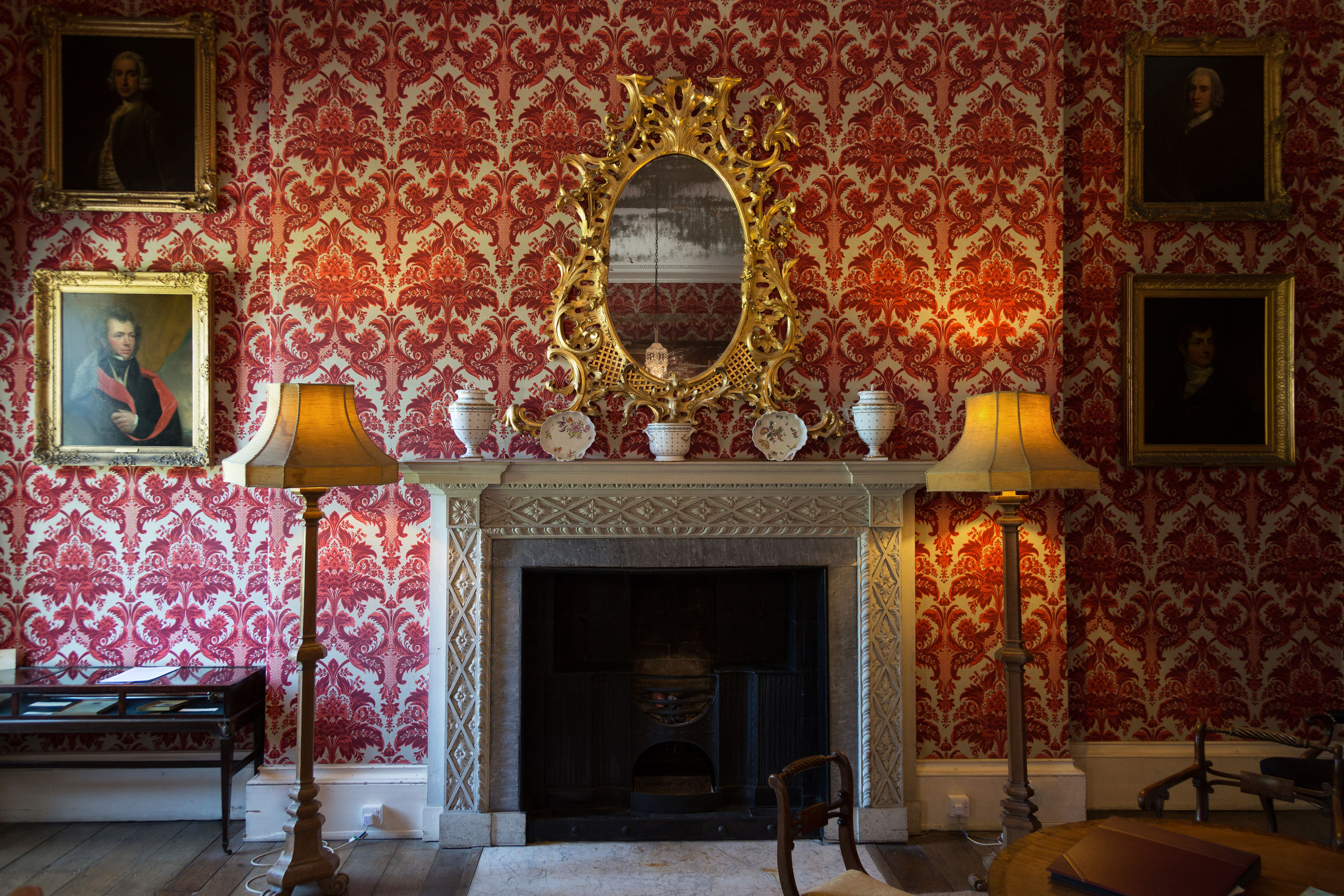 architecture, built structure, indoors, building, no people, pattern, fireplace, art and craft, design, creativity, window, wall - building feature, wall, illuminated, lighting equipment, the past, floral pattern, history, red, absence, mural, ornate