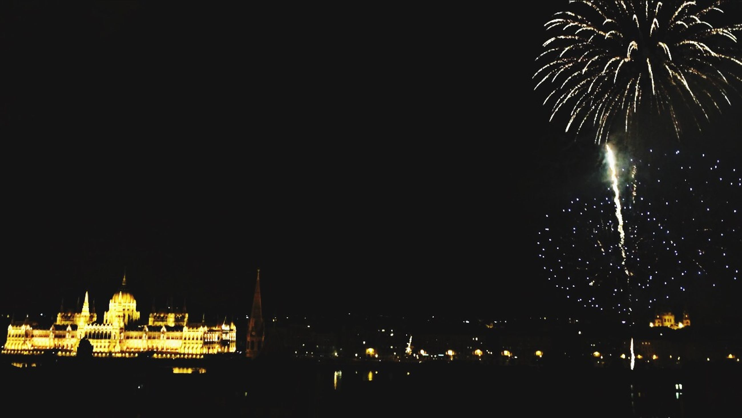 night, illuminated, building exterior, architecture, built structure, city, clear sky, travel destinations, copy space, famous place, cityscape, international landmark, glowing, religion, travel, sky, tourism, dark, outdoors, firework display