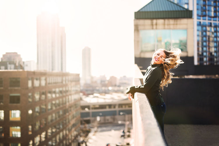 Rooftop Adult Adults Only Architecture Beautiful Woman Beauty Blond Hair Building Exterior Built Structure City Cityscape Day Long Hair Looking At Camera One Person One Woman Only One Young Woman Only Only Women Outdoors People Portrait Skyscraper Smiling Young Adult Young Women